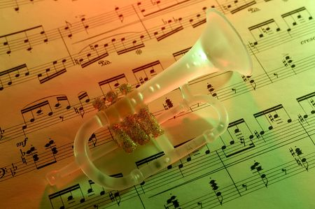 Photo of Sheet Music and a Trumpet Christmas Ornament With Gel Lighting Stok Fotoğraf