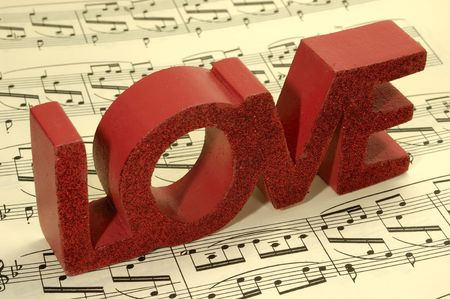 sheetmusic: Photo of Sheetmusic With The Word Love on Top.