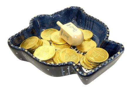 gelt: Photo of a Chanukah Dish With a Dreidel and Gelt (Chocolate Coins) - Chanukah Related