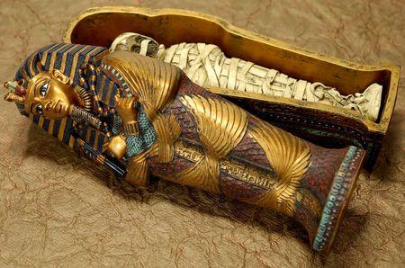 Photo of a Pharoahs Tomb and Mummy