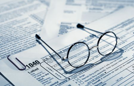Photo of of Eyglasses on Top of Tax Forms - Tax Related