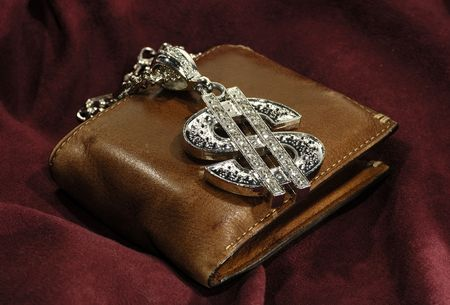 Photo a Silver Dollar Symbol Necklace and a Wallet - Money Concept photo