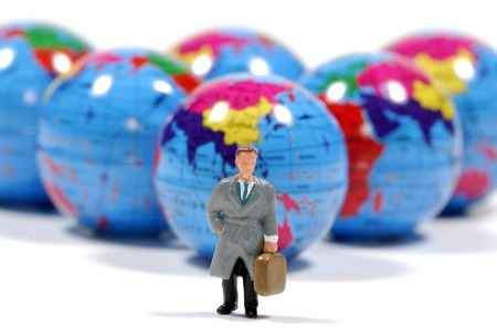 minature: Photo of Minature Globes and a Miniature Man - Business Travel Concept