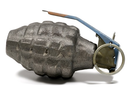 frag: Photo of a Hand Grenade - Weapon  War Related Stock Photo