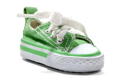 athletic wear: Photo of a Green Sneaker - Everyday Object Stock Photo