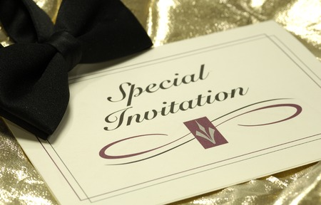 Photo of an Invitation and a Bow Tie - Event Related Stock Photo