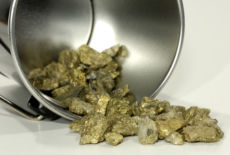 Photo of a Bucket and Gold Nuggets