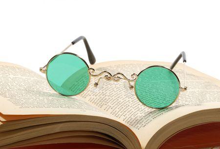 bifocals: Photo of Bifocals on a Book - Reading Concept