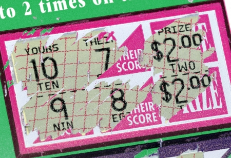 Photo of a Scratched Lottery Ticket Stock Photo