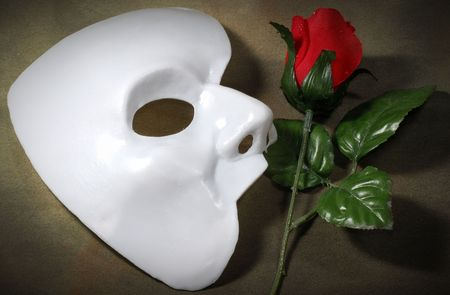 theatre mask: Photo of White Mask and a Fabric Rose - Opera Concept