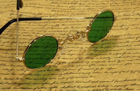 Photo of VIntage Eyeglasses on a Parchment