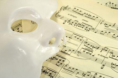 phantom: Photo of a Mask on Sheetmusic - Opera  Theater Concept