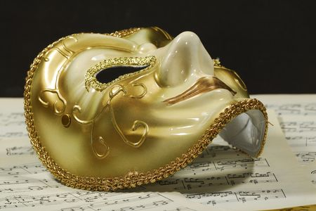 Photo of a Mask on Top of Sheetmusic - The Arts  Opera Concept photo