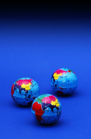 Photo of Globes on a Blue Surface - Map / Atlas Related - Background Stockfoto
