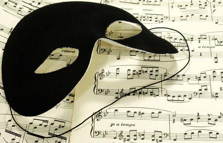sheetmusic: Photo of Sheetmusic With a Black Mask - Sheetmusic Background