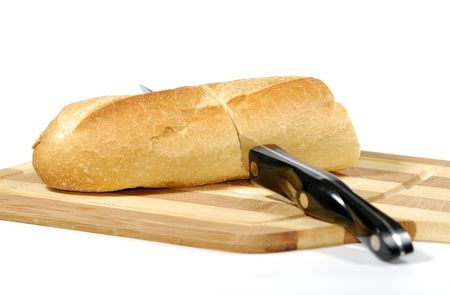 Photo of Bread on a Cutting Board With a Knife - Sliced Bread Stockfoto