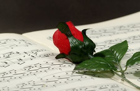 sheetmusic: Photo of Sheetmusic With Red Fabric Rose - Sheetmusic Background