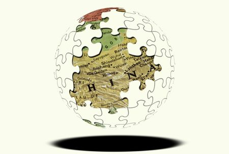 Puzzle Sphere with Map Showing THrough Missing Pieces. Redactioneel