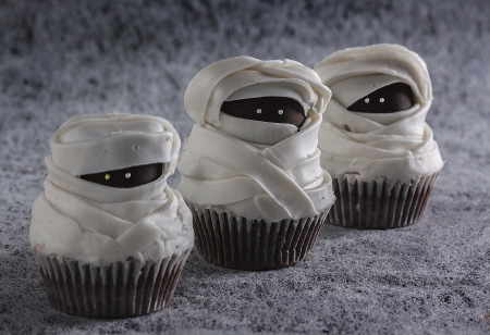 Sweet and scary mummy muffins with snowy background