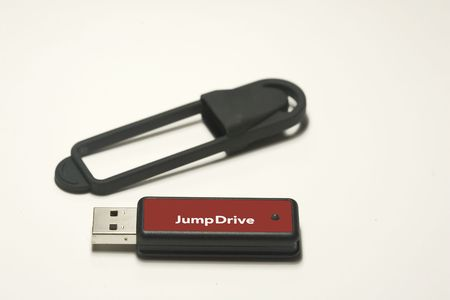 capacities: Jump Drive and protective Case on White