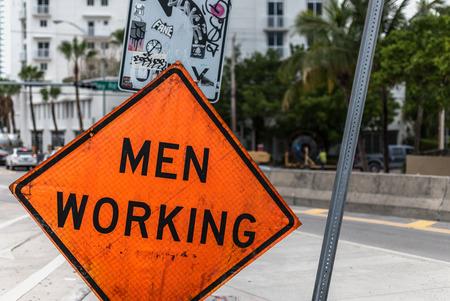 disruption: Men Working - sign Stock Photo