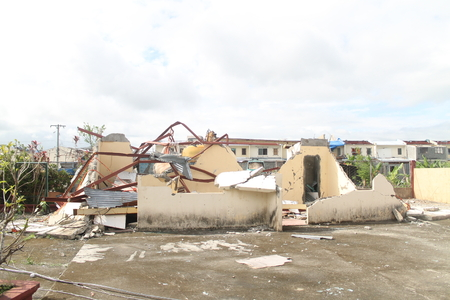 typhoon: House destroyed by typhoon photo Stock Photo