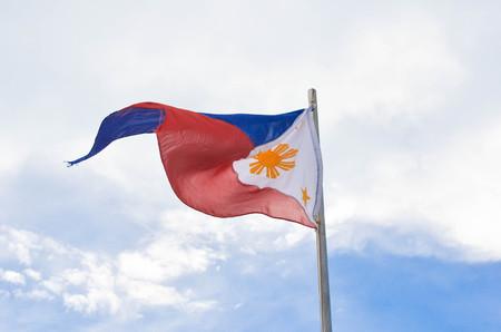 philippine: Philippine flag on sky background photo Stock Photo