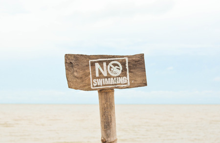 no swimming: Wooden no swimming sign photo Stock Photo