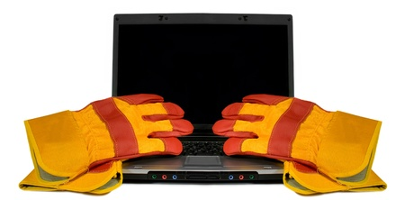 Protective gloves on a laptop isolated. Empty black desktop for your text. Industrial concept