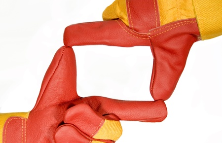Frame made from red protective gloves photo
