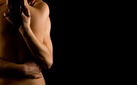 male nude: Mani che abbraccia una ragazza di passione Archivio Fotografico