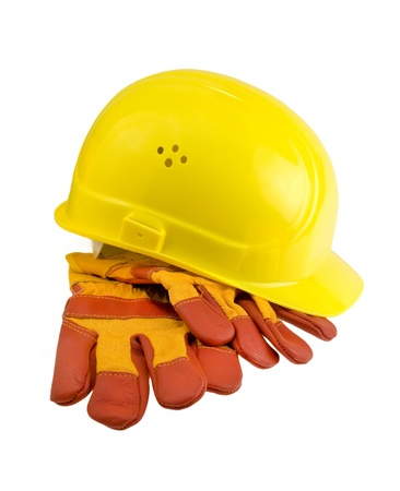 personal safety: Yellow hard hat, protective gloves and steel isolated