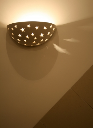 Modern,abstract looking wall lamp (Sconce). photo