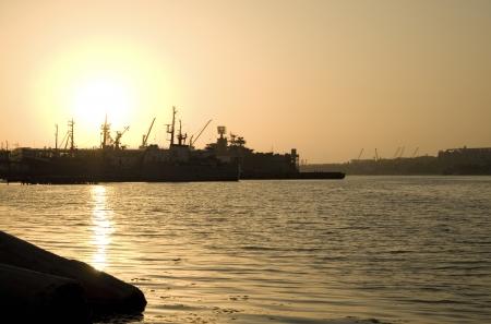 Several ships at sunset photo