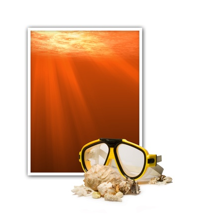 Frame with underwater scene and diving mask with sea shells photo