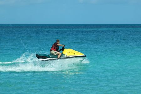 jetski: Man on jetski taking a ride on the ocean