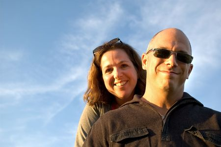 Happy woman and man (facing light at sunset - Models are 35 years old) Stock Photo