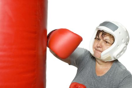 Woman in her 60s punching bag.  The sweat was staged but the punch is real.