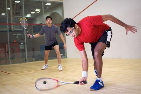 racquet: Men playing squash
