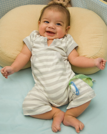 giggling: Happy baby giggling Stock Photo