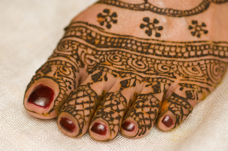 Henna just applied on brides foot.