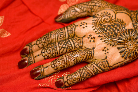 Henna just applied on brides hand.