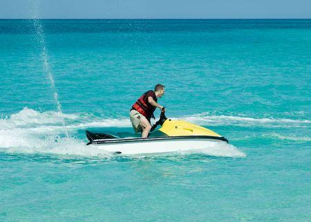 Man on jetski taking a ride on the ocean