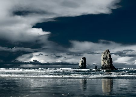 Monolith: Landscape of standings rock on Beach Stock Photo