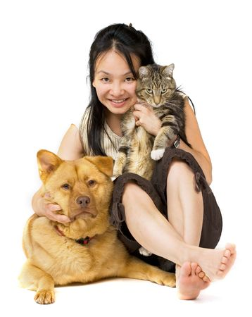 Woman hugging her cat and dog.