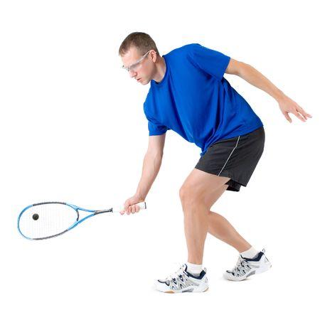 forehand: Squash player hitting forehand isolated on white  Stock Photo