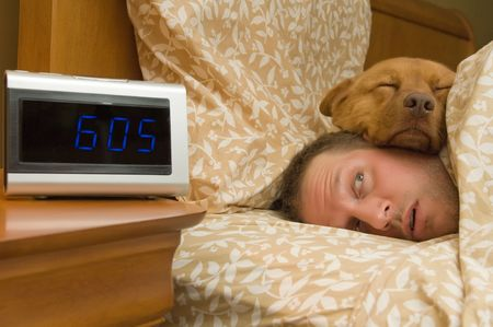 Man waking up with dog comfortably sleeping in Stock Photo - 3900031