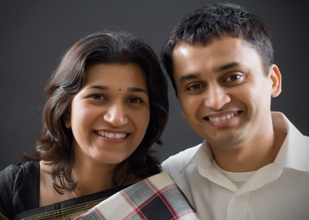 Happy Indian ethnicity couple posing.