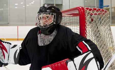 Ice hockey goalie protecting his net photo