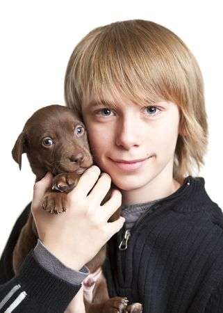 Young teennage boy with brown puppy photo